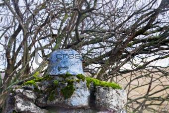 old steel helmet on war memorial in Alsace
