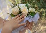 Bouquet of flowers in his hands the bride.
