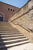 stone stairs with metal banister