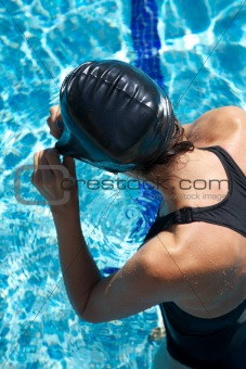 swimmer placing cap