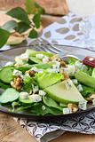 Salad with apple, cheese and walnuts
