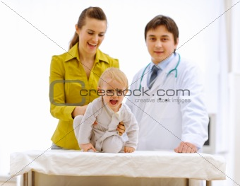 Portraits of mother, baby and pediatric doctor