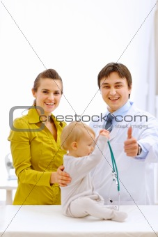 Portraits of baby, mother and pediatric doctor showing thumbs up