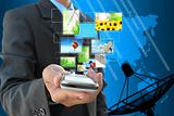 businessman hand holding streaming images virtual buttons and satellite dish antennas