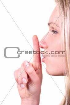 shh - woman with finger in front of her lips