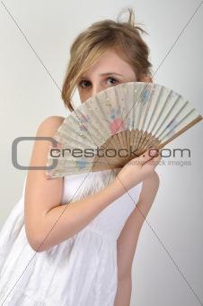 beautiful girl hiding behind a fan