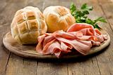 Mortadella with Bread on Chopping board