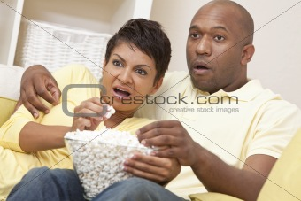 Happy African American Woman Couple Eating Popcorn