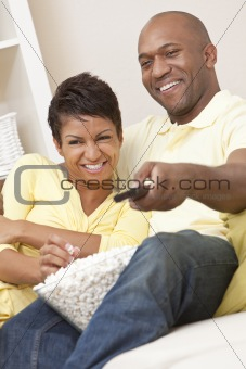 African American Couple Eating Popcorn Watching Television