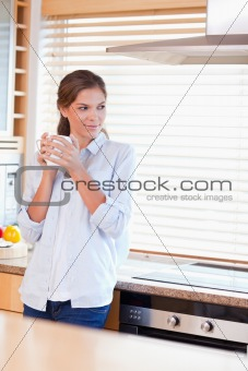 Portrait of a calm woman holding a cup of coffee