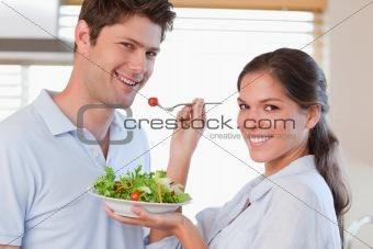 Housewife feeding her husband