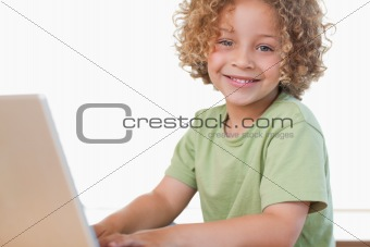Boy using a notebook