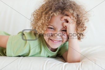 Boy lying on a sofa