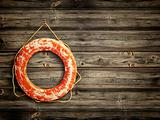 lifebuoy at wooden background