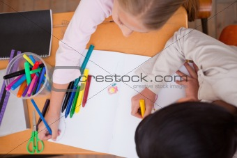 Above view of schoolgirls drawing