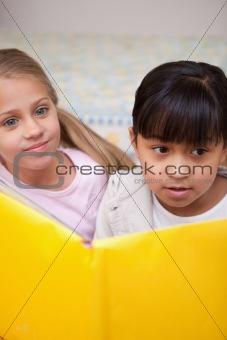 Portrait of schoolgirls reading