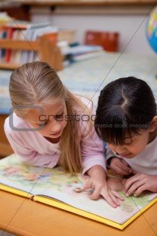 Portrait of schoolgirls reading a fairy tale