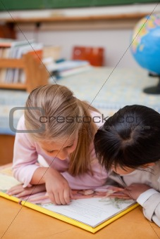Portrait of focused schoolgirls reading a fairy tale