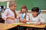 Little schoolgirls reading a fairy tale to their classmate