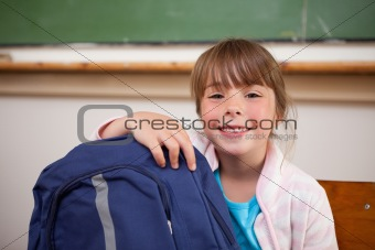 Smiling schoolgirl posing with a bag
