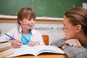 A teacher and a schoolgirl talking