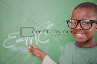 Smart schoolboy showing the mass-energy equivalence