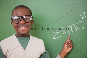 Smart schoolboy showing the the mass-energy equivalence formula
