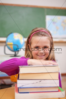 Portrait of schoolgirl posing with books