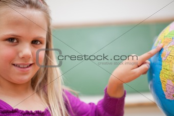 Close up of a schoolgirl pointing at a country