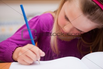 Close up of a schoolgirl writing