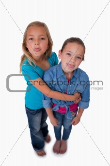 Portrait of girls sticking out their tongues