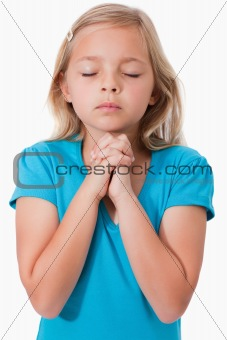 Portrait of a young girl praying