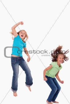 Portrait of girls jumping