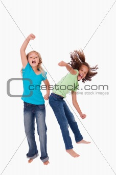 Portrait of cheerful girls jumping