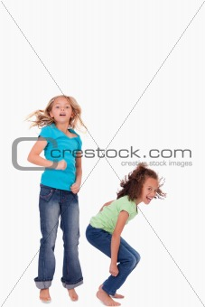 Portrait of happy girls jumping