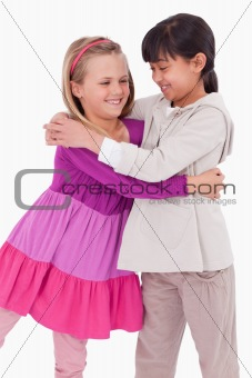 Portrait of girls hugging