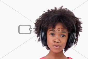Close up of a girl listening to music