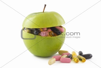 Apple with pills, isolated