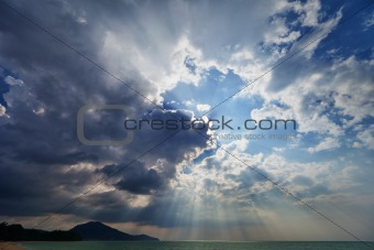 Sky over the sea with rays of sun