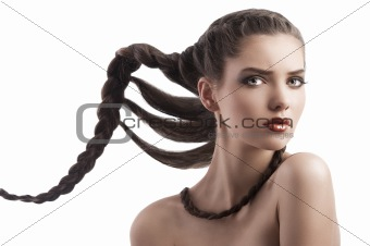 beauty shot  hairstyle portrait of beautiful brunette girl with creative braid hairdo and naked shoulder