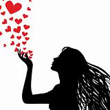 Silhouette woman blowing heart