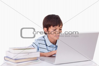 Boy working with a laptop
