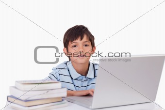 Boy working with a notebook