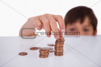 Little boy counting his change