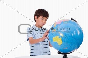 Boy looking at a globe