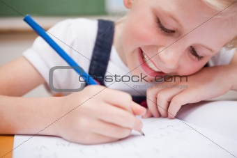 Close up of a schoolgirl writing something