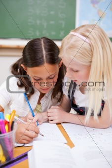 Portrait of pupils working together on an assignment
