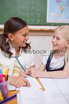 Portrait of happy pupils working together on an assignment
