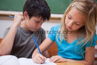 Focused pupils working together