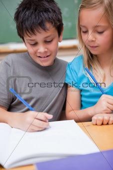 Portrait of smiling pupils working together